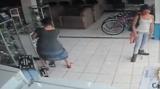 Women steals TV by putting it under her dress.