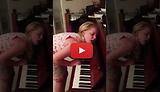 Girl playing the piano while sleepwalking.