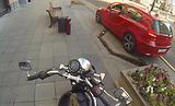 Elusive girl on a motorcycle against debris