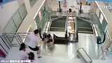 Mother Throws Son to Safety Before Falling to Death in Escalator Horror - Woman Dies Swallowed